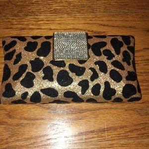 Charming Charlie Leopard print clutch